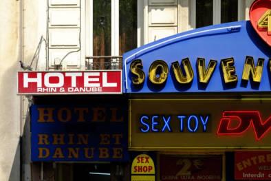 Montmartre Pigalle By Day. Signage. Quest - Im Wandel Der Zeit. By Oliver Lins